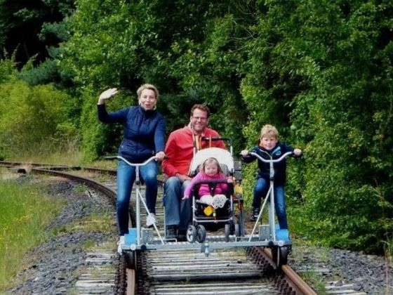Family with a stroller on the Eder-cycle handcar