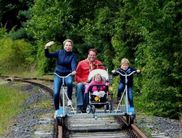 Riding a cycle handcar can be done on the decommissioned railway tracks along Lake Affoldern