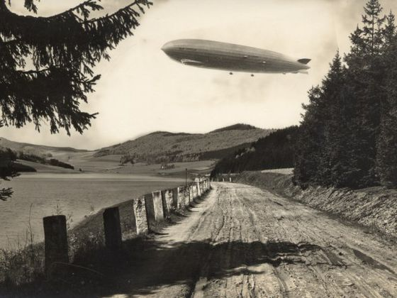 An archive photo of the Diemelsee Nature Park with a zeppelin overhead