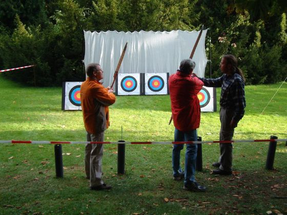 After practicing basic archery techniques, the participants take aim at the targets